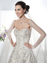 1473 Beaded Chantilly Lace, A-line wedding gown with a sweetheart neckline. The back on this bridal dress features buttons over the zipper and Chapel length train.
