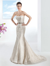 1474 Venice lace, strapless, fit and flare wedding gown with a Soft Sweetheart neckline. This bridal dress has a Chapel train. Jeweled belt style BL40 sold separately.