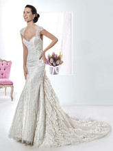 1477 Chantilly lace fit and flare wedding gown with a Sweetheart neckline, sheer lace cap sleeves and open keyhole back. This bridal dress also features a tiered lace train with flowers and Chapel train.