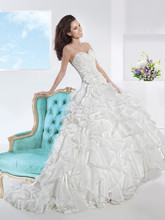 3197 Chantilly lace and Organza, Strapless wedding gown with a Sweetheart neckline and ruched bodice with a lace-up back. This bridal dress has a full multi-ruffled skirt featuring a Chapel length train.