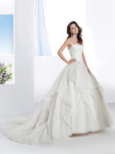 3198 Organza, Strapless wedding gown with a ruched bodice and full A-line soft tulle skirt with handkerchief Organza overlay. This bridal dress has a Chapel length train.