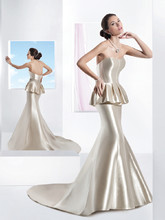 3199 Mikado Satin, Strapless, fit n flare wedding gown featuring a corset bodice. This bridal dress features a pleated peplum and Chapel train. Jeweled belt style BL42 sold separately.