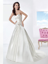 3201 Crystal Organza, A-line wedding gown featuring a Sweetheart bodice with lace-up back, asymmetrical inverted pleats and beaded motif on waist. The skirt on this bridal dress is finished with a Chapel length train.