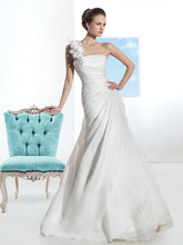 3202 Satin Organza, A-line wedding gown with flowers on one-shoulder and asymmetrical pleating on bodice. The skirt on this bridal dress features a side split with ruffles and attached Chapel train.