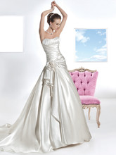 3205 Crystal Organza, Strapless, A-line wedding gown with a soft Sweetheart neckline, lace-up back and asymmetrical pleating with flower on bodice. The skirt on this bridal dress features a side, ruffled pick-up and attached Chapel train.