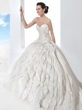 3206 Satin Organza, Strapless wedding gown with a Sweetheart neckline, lace-up back and asymmetrical pleating with three-dimensional beaded motif on bodice. This bridal dress has a full A-line skirt featuring multi-tiered vertical ruffles and Chapel train.