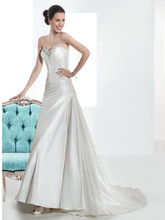3208 Taffeta, Strapless, A-line wedding gown with a beaded Sweetheart neckline, wrapped bodice with asymmetrical pleating and lace-up back. The skirt on this bridal dress features a wrapped side split and Chapel length train.