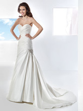 3209 Taffeta, fit n flare wedding gown with a Sweetheart neckline and asymmetrical pleats. The skirt on this bridal dress features a wrapped side pick-up with jeweled motif and attached Chapel train.