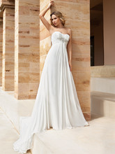 186 Chiffon, Strapless destination wedding gown with a Soft Sweetheart neckline and Empire ruched bodice embellished with beaded motif. The A-line skirt on this bridal dress features a Chapel train.