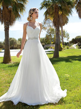 199 Chiffon, A-line halter destination wedding gown with a Sweetheart neckline and ruched bodice. Waist and halter straps are embellished with jeweled beading. The skirt on this bridal dress features a Chapel train.