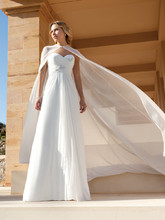 207 Chiffon, Strapless, Sweetheart neck, A-line destination wedding gown with a ruched, Empire bodice and 3 dimensional beading. This bridal dress features a chiffon cape and Chapel length train.