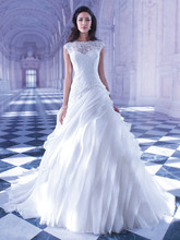 251 Venice lace, A-line wedding gown with a sheer high neckline and a-symmetrically pleated Organza skirt. The high sheer lace back on this bridal dress features buttons over zipper and attached Chapel train.