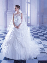 253 Chantilly lace, sleeveless wedding gown with a Sweetheart bodice, low V-back with buttons and Sheer lace neckline. This bridal dress features a ribbon with bow around empire waist and Organza, wrap-around, pick-up skirt with lace and tulle underlay and Chapel length train.