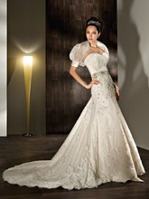 1406 This wedding gown is a lace, strapless, sheath with a sweetheart neckline. The ruched wrap bodice and organza bolero jacket are features of this bridal dress. The beaded belt is sold separately.