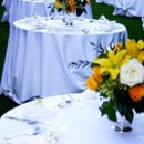130x130 sq 1244748907646 roundtablesyellowflowers