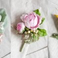 130x130_sq_1248756850572-boutonnierscollage2