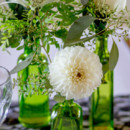 130x130 sq 1418154745078 green vase jar flower centerpieces