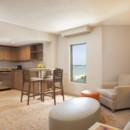 130x130 sq 1442517290014 one bedroom suite kitchen and livingroom