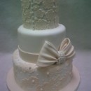 130x130 sq 1456843547062 lace and bow wedding cake