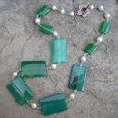 130x130 sq 1243478146730 emeraldeyescollection1