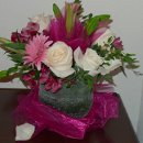 130x130 sq 1363909407639 pinkwhitegreencenterpiece