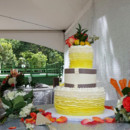 130x130 sq 1449362617110 yellow orange and geay cake