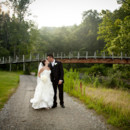130x130 sq 1418932067827 mp couple on dirt road with bridge