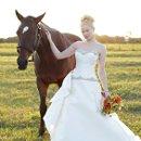 130x130 sq 1349124507550 bridewithhorse1