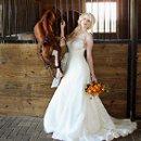 130x130 sq 1349124519411 bridewithhorse2