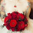 130x130 sq 1413862478907 rockabilly mixed red bouquet 2