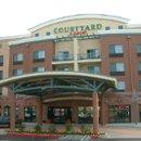 130x130 sq 1242077177687 hotelentrance