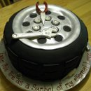 130x130 sq 1286837706387 tiregroomscake2