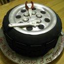 130x130_sq_1286838312918-tiregroomscake2