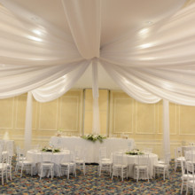 220x220 sq 1487088168926 white chivari and drapes