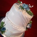 130x130_sq_1276724749642-whiteblueweddingcake