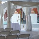 Whether you call this a Chuppah or a Wedding Canopy you will find this both Elegant and Opulent. The fabric used is sheer and adds Elegance to any Wedding Ceremony. Can you picture yourself being married under this Wedding Canopy? See our Wedding Photos of actual couples being married under this canopy. What a photo op!!!! Call me for pricing and availabilty. Available for Rent indoor as well as in the many Parks in Savannah.