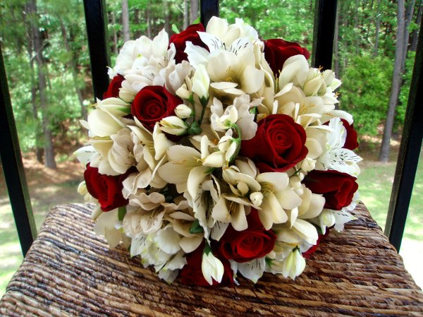 Ivory red aisle markers bouquet boutonniere centerpiece