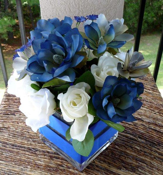 1291621865376 BlueMagnoliaWhiteRose004 Savannah Wedding Florist