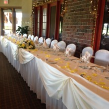 220x220 sq 1416603445421 head table by brick wall