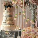 130x130_sq_1405699767831-tall-wedding-centerpiece-ideas-pearls-branches-5a