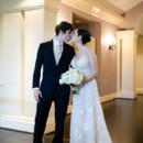 130x130 sq 1445010203127 indoor bride and groom kiss