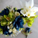 Combination of a Bridal Bouquet, Boutonniere and Bridesmaid Bouquet. THESE ARE SILKS SAVANNAH EVENT DECOR