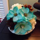 Bridal or Bridesmaid's Bouquet in Teal Magnolia and Creamy Roses with touches of Brown Roses. The collar is a fabulous soft satin in cream and the handle is pearl wrapped. Price depends on size.
