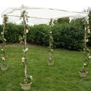130x130 sq 1288998980744 vineyardchuppah