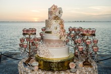 220x220 1423479685708 nikerendira   wedding cake   the cake zone the rin