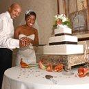 Bride & groom cutting cake at wedding reception