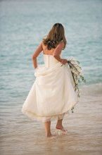 220x220 1331574938795 bridewalkinginocean