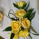 130x130 sq 1257105559279 yellowrosecorsage