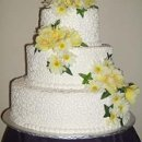 130x130 sq 1246572218031 weddingcakeyellowflowers