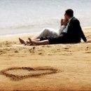 130x130_sq_1359910680283-weddingcouplelayingonthebeachsandalsresortjamaica